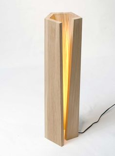 This is an interesting looking wooden table or floor lamp.