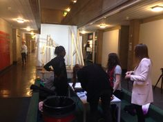 DJCAD Dundee Interior Environmental Design students intercultural collaboration with Amsterdam, Texas, Ljubljana and Dundee using Socratic Dialogues Design Final presentation board 3. Border Crossings project 2014-15. Setting up for the event on Floor 5 of DJCAD building