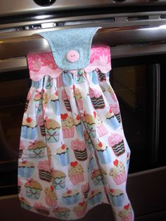 Hanging Dish Towel - Cupcakes. $9.50, via Etsy.  Nice to have a clean towel without the kids swiping it or it landing on the floor!