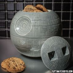 Death Star Cookie Jar - That's no moon! It's a cookie jar shaped like the death star! This jar comes straight from the Star Wars Shop, it's entirely from durable Polyresin and features a counter-friendly flat base for proper counter storage.