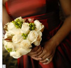 In contrast to the vibrant hues of their dresses, Kim's two attendants carried bouquets of cream-colored roses.