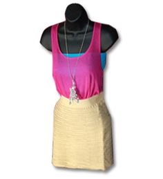 How cute is this fashion statement? Perfect to dress up or down! Let us count the ways. A lightweight, airy tank top that is featured in fushia, lime green, royal blue and gray, paired with a soft and subtle textured skirt. Plus a dangling charm necklace that finishes this statement-making look as you accessorize for the new season.