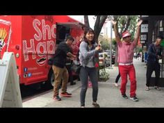 Friends dancing at the Pocky truck in Los Angeles Little Tokyo.