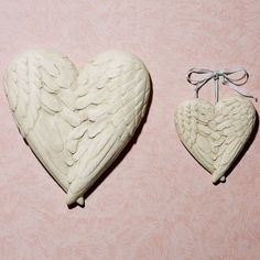 """My Heart Has Wings Plaque. Beautiful angel wings in white made of resin. Measures 5""""x5.5"""" and the larger one measures 9""""x10"""".  The side reads, """"You give my heart wings."""" Can be displayed indoors or outdoors under a covered patio. Costs $13.99 for a small and $25.99 for the large. I hope these aren't too girly or grandma style for the BF. I'm really liking this site, too. They have very pretty and useful things :3"""