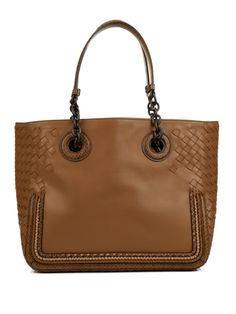 The impeccable details of this tan nappa-leather shoulder bag highlight Bottega Veneta's artisanal capabilities. It features the label's iconic intrecciato weave at the sides and base, and is accented with piped edges and brown snakeskin accents. A roomy design, it's ideal for busy office days and weekends in the city.