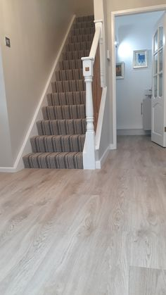 Telenzo Stripe Carpet to Stairs and Moduleo Impress Sierra Oak to Hallway installed by Crowe Flooring Moduleo Flooring, Striped Carpets, Grey Flooring, Stairs, Living Room, Cool Stuff, Home Decor, Floor, Gray Floor