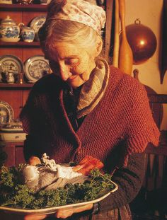 Tasha Tudor, she would shock her guests by presenting her pet parrot on a platter! I guess he liked to perform!