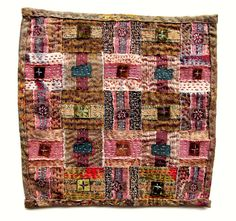 """""""Nostalgia"""" by Morna Crites-Moore. Many strips of recycled textiles have been woven together, Japanese boro style and quilted with kantha stitch, which is a running stitch. It measures 10"""" x 10"""" and is composed of scraps from old linen skirts, a friend's shirt, antique kimono silk, vintage velvet ribbons, a piece of upholstery fabric, and more."""