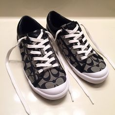 New [Coach] black and grey sneakers size 10 Brand new [Coach] sneakers, black and grey. Never once worn and have that new shoe smell:) so cute and stylish. Women's size 10 Coach Shoes Sneakers