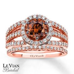 A 1 carat round Chocolate Diamond adorns the center of her tantalizing engagement ring in this set from the Chocolate Weddings Collection by Le Vian