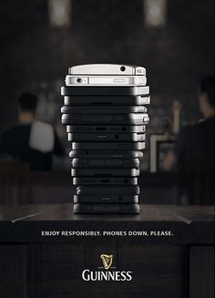 """Guinness - """"Enjoy Responsibly. Phones Down, Please."""" advertisement."""