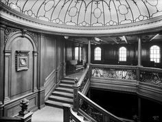 The Aft Grand Staircase aboard RMS Olympic, Titanic's sister-ship, as seen from A Deck. Titanic's Aft Grand Staircase was similar to this, the main differences being two additional staterooms on A Deck (one room was occupied by Thomas Andrews, the other by Father Francis Browne), and a Reception Room for the A la Carte Restaurant on B Deck. The Aft Grand Staircase was essentially a smaller and slightly less elegant version of the famous Forward Grand Staircase.