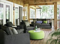 Love the dark grey sofa with lime/blue accents