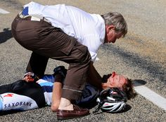 Unfortunate Jens Voigt is attented to by his team's doctor after a crash