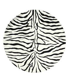 @Overstock - Walk on the wild side in your living room, den or office Floor rug is hand-tufted of 100-percent wool pile Area rug features a vibrant zebra stripe motifhttp://www.overstock.com/Home-Garden/Hand-tufted-Zebra-Stripe-Wool-Rug-6-ft-Round/2487306/product.html?CID=214117 $141.09