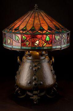 ONONDAGA COPPER AND IRON TABLE LAMP WITH LEADED GLASS SHADE  Onondaga Metal Shops, Syracuse, New York, circa 1906