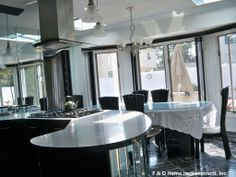 It's a black and white world for these homeowners. Remodeled kitchen features black marble tile floors, steel appliances and a white chandelier. If you are thinking about remodeling your kitchen, click on the Pin to see the five questions you must ask yourself.
