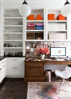 A lovely home office space tucked alongside a kitchen area