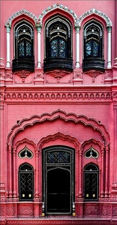 The heart-shaped windows and pink tint of the Omar Hayat Mahal in Pakistan.
