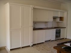 hide away bespoke kitchen - Peter Henderson Furniture, Brighton, UK
