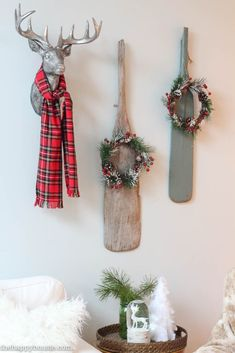 Come tour this Christmas living room with lots of natural and rustic vintage touches as well as hits of red - coastal lake cottage Christmas at thehappyhousie.com-31