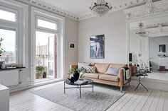 A stunning turn of the century apartment in Sweden updated with modern  finishes. I love the detail that has been maintained from the original  structure including picture rails, cornices and doorways. The chandeliers  paired back with minimal Scandi furniture add the perfect finishing  touch...  Images via Alvhem