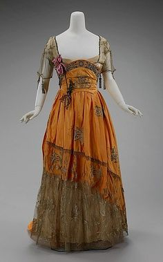 Harvest worthy hues combine in this lovely, partially sheer Edwardian dress c. 1910-1914.