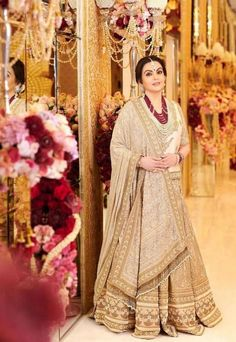 Nita Ambani, was seen in a faint gold and off-white lehenga by the designer for Akash Ambani and Shloka Mehta's Mala Mehendi celebrations. The pristine details and embellishments worked their charm, as one would expect from a Sabyasachi offering. Red Lehenga, Bridal Lehenga, Lehenga Choli, Anarkali, Bridal Gown, Mother Of Bride Outfits, Mother Of The Bride, Starry Wedding, Nita Ambani