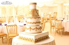 Five Tier Gold Regal Asian Wedding Cake setup within the marquee of the grounds of Cobham Hall