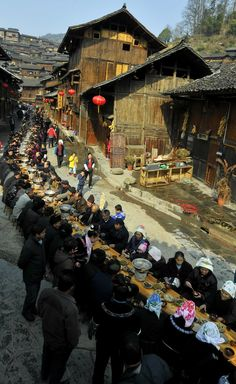 Meals are served at an event marking the upcoming Spring Festival in a Miao ethnic group village February 1, 2011 in Xijiang Town, Leishan County, Qiandongnan Miao and Dong Autonomous Prefecture, in southwest China's Guizhou Province. Around 1,000 residents and tourists dined around a 280-meter-long table.