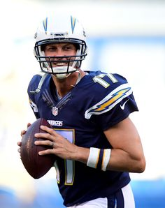 Philip Rivers of the San Diego Chargers smiles as he warms up before a preseason game against the San Francisco 49ers at Qualcomm Stadium on...