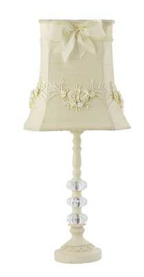 The bow silk shade on this table lamp, in addition to the beautiful base, really make it a special focal piece for any room. Not bad for $128.  Jubilee Collection,   www.thepepperkids.com