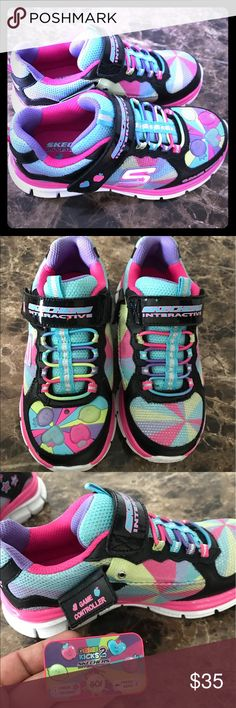Sketchers girls light up game sneakers 👟 size 3 It gorgeous multicolored with light up game I bought this for my daughter she just tried on but was small for her had to buy her bigger size they are new without box just tried on retail 65$ sketcher Shoes Sneakers
