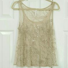 Willow & Clay Sequin Sheer Tank Top 100% polyester Gently used. No stains or rips. No size on the label but I wear a small/medium and this fits me.  Sheer/see through Willow & Clay Tops Tank Tops