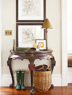 A demilune table graciously curtsies a greeting, turning a bare stretch of wall into a welcoming foyer: http://www.bhg.com/home-improvement/storage/friendly-and-functional-entries/?socsrc=bhgpin042414sliverofspace&page=9
