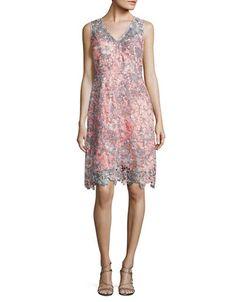 """<ul><li>Floral lace cutout dress imparts feminine flair</li><li>V-neckline</li><li>Sleeveless</li><li>Scalloped hem</li><li>Back zip closure</li><li>Lined</li><li>Polyester</li><li>Dry clean</li><li>Imported</li><li>Model shown is 5'10"""" (177cm) wearing US size 4</li></ul>"""