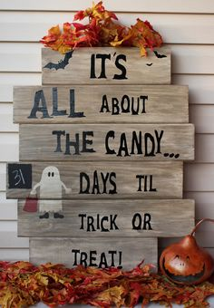 It's All About The Candy...Primitive Wooden Trick or Treat Countdown Sign with Mini Chalkboard. $39.00, via Etsy.