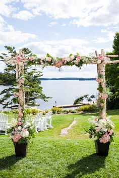 Floral backdrop overlooking Lake Muskoka, Canada. Photography By / abritandablonde.com, Floral Design By / seasonsinthecountry.com
