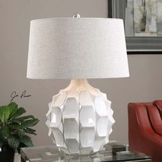 The Uttermost 27052 Guerina Scalloped Table Lamp brings a textured appearance to your home with its scalloped distressed white ceramic base and slightly. White Table Lamp, Light Table, Best Desk Lamp, Lampe Decoration, Contemporary Table Lamps, Modern Lamps, Unique Lamps, Modern Table, Contemporary Furniture
