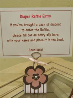 Diaper Raffle that I did for my baby shower. I made my own table tents by using binder clips that I re-purposed and decorated myself. My handy cricut machine helped with the flower design. The diaper raffle card was printed on gloss Avery perforated business card sheet. I also made several of these table tents for the food table.