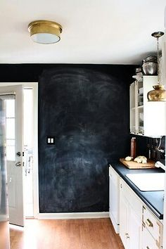 Blackboard wall in vintage kitchen. How cool! Goes with black, matte countertop