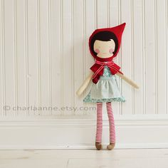 Meet Little Red RIding Hood. She is one of a kind and handmade with love.    features include...    brown wool hair  hand stitched face  removable