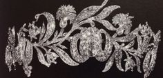 A 19TH CENTURY DIAMOND TIARA Composed of a graduated line of seven old-cut cushion shaped diamond collets within diamond-set fleur-de-lys motif cluster surrounds, raised on a similarly-set diamond frame, later rhodium plated. Image Christies