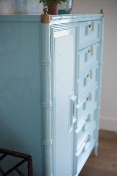 You will love the way light reflects off of this glossy painted faux bamboo chest of drawers. Take a look at how this dresser looked before its glossy makeover, you won't believe it!