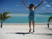 Jumping for Joy in Atutaki.  Cook Islands was a ball.  Love that aqua blue water.