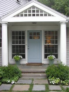 blue door- I'm totally painting our black door next year.Something greyish-blue like this!
