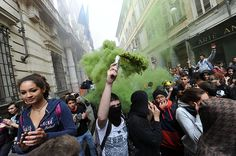Turin, Itlay: A protester lights a smoke bomb during a student demonstration