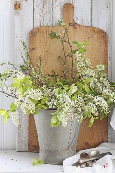 #shabbychic is flowers in a tin or bucket