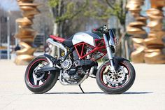 This Ducati 900 Supersport based build is the first custom of a young designer, Angel Lussiana of Turin, Italy. Check out the pics and specs of the build.