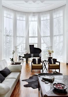 What could be more glamorous than a piano, floor to ceiling windows, and artfully draped curtains?   Luxurious House Design by Russian Architects, Black and White Decorating